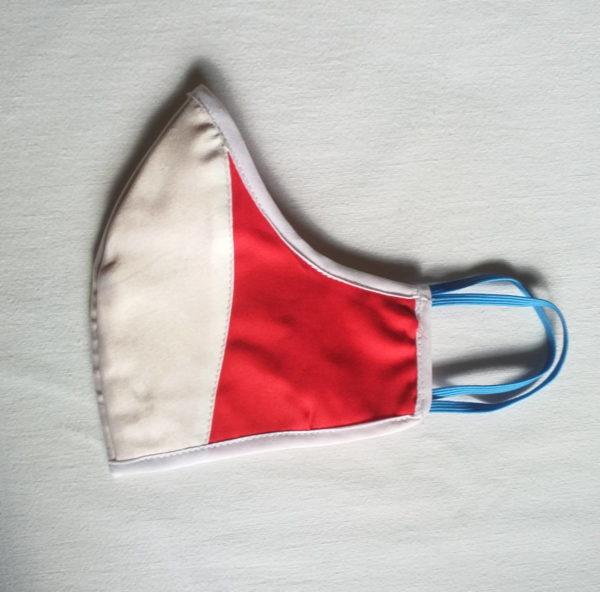 Masque facial blanc et rouge en provenance du Gabon